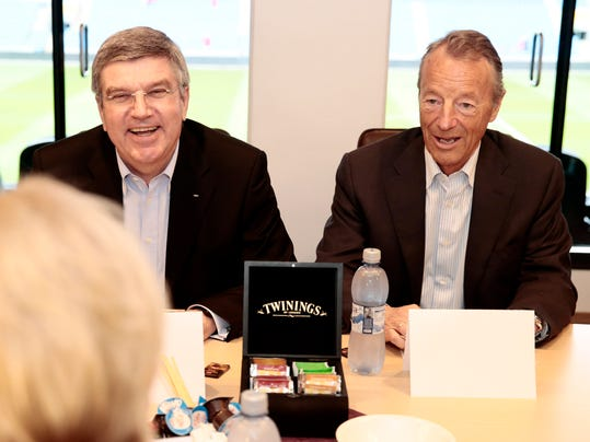 International Olympic Committee President Thomas Bach. left,  smiles  as he sits with Norwegian IOC-member Gerhard Heiberg  during a meeting Norway's Minister of Culture, Thorhild Widvey in Oslo Monday May 19, 2014. Bach was in Oslo is discuss the 2022 Oslo Winter Olympic bid.(AP Photo: Hakon Mosvold Larsen / NTB scanpix) NORWAY OUT