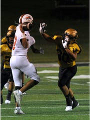 Abilene High School linebacker Marqus Franklin pressures