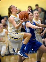 Northern Lebanon's Megan Brandt (11) drives to the hoop for two of her 16 points on Thursday night in the Vikings' 47-35 win over Cocalico.