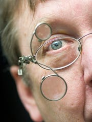 Dan Nied, director of the York Time Institute, wears a double loupe on his glasses, which allow him to view extremely small time piece parts with an either a three times or five times magnification.