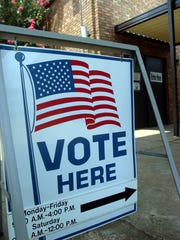 Signs point the way to early voting sessions at the