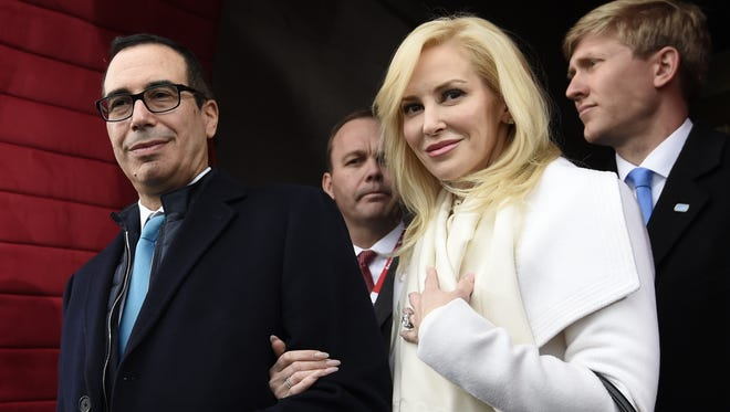 In this Friday, Jan. 20, 2017, file photo, Treasury Secretary-designate Steven Mnuchin and his fiancee, Louise Linton, arrive on Capitol Hill in Washington, for the presidential inauguration of Donald Trump.