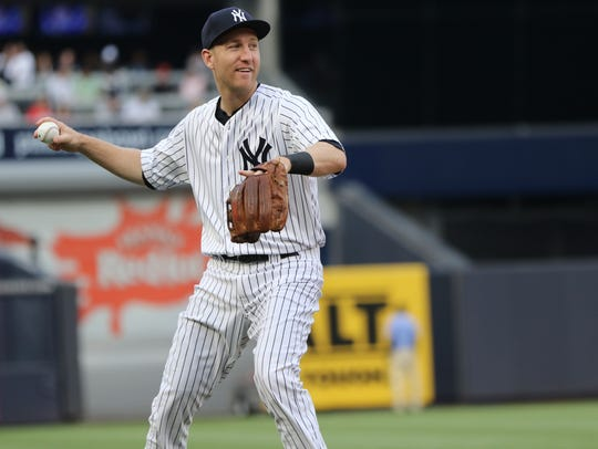 Todd Frazier throws to first base between innings against
