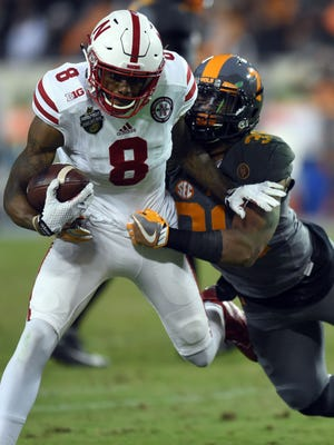 Tennessee linebacker Darrin Kirkland Jr. (34) tackles Nebraska wide receiver Stanley Morgan Jr. (8) during the second half of the Franklin American Mortgage Music City Bowl at Nissan Stadium on Dec. 30, 2016.