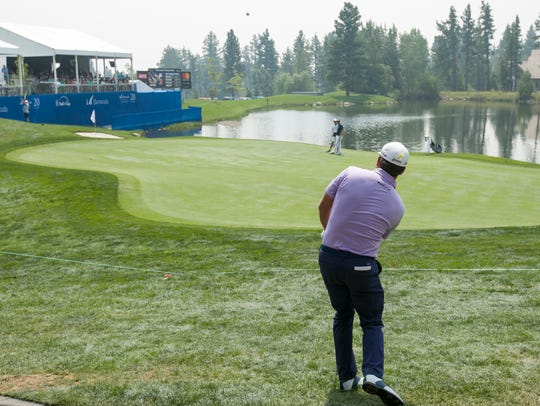 Graeme McDowell chips onto the18th green during the