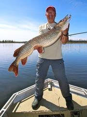 Dan Armitage shows off his 41-inch pike that was caught