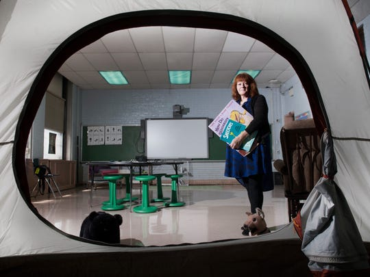 Dr. Linda Brown-Bartlett  is seen through the entrance of a camping tent  in her calming classroom  for kids struggling to cope with home and school stress at Yorkship Family School in Camden.