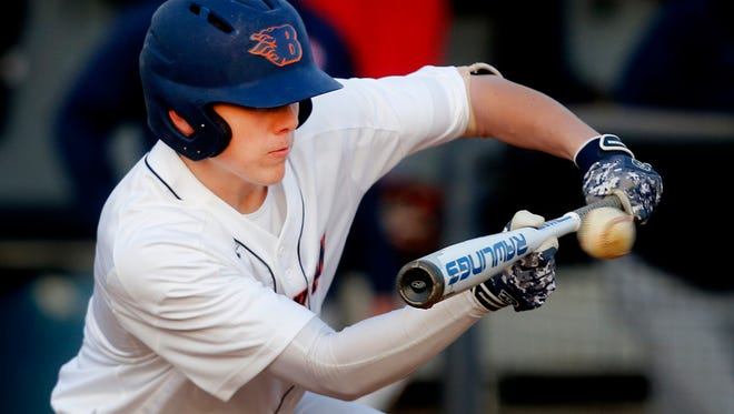 Blackman's Blaze Bell (4) bunts the ball during the game against Oakland on Tuesday, April 10, 2018, at Blackman.