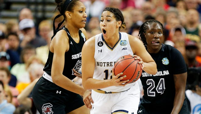 TAMPA, FL - APRIL 05:  Taya Reimer #12 of the Notre Dame Fighting Irish drives against A'ja Wilson #22 of the South Carolina Gamecocks in the first half during the NCAA Women's Final Four Semifinal at Amalie Arena on April 5, 2015 in Tampa, Florida.