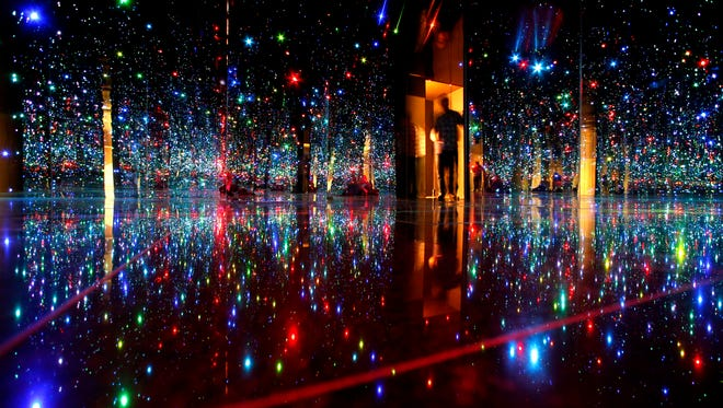 """Yayoi Kusama """"Fireflies""""  at the Phoenix Art Museum is a place I find so peaceful. At first there is an illusion of floating in space but as my eyes adjust I love seeing the ever changing colored lights."""