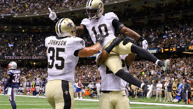 Saints wide receiver Brandin Cooks celebrates after a touchdown with fullback Austin Johnson, left, and running back Mark Ingram during a preseason game against the Patriots.