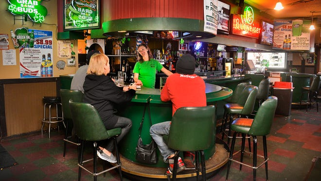 Mandy Hansen tends to a small flock of regulars at the bar inside the Lincoln Depot on March 11 in St. Cloud.