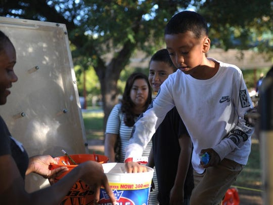 Lauren Roberts/Times Record News Isaac Delgado picks out a candy prize Saturday, Oct. 22, 2016, at the Wichita Falls Parks & Recreation Department's A Lucy Park Halloween.
