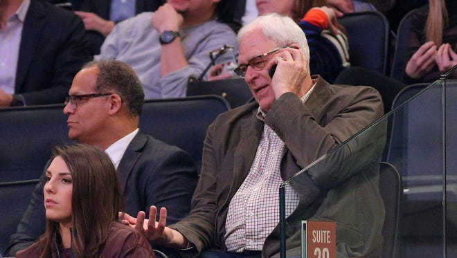 New York Knicks President Phil Jackson talks on his phone during a February game against the Los Angeles Clippers at Madison Square Garden