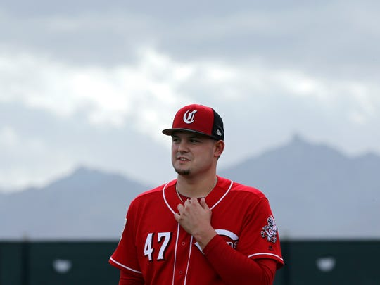 Cincinnati Reds pitcher Sal Romano waits during drills