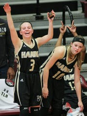 T.L. Hanna senior guards Khloe Saunders, left, and Maggee Bolt celebrate a 61-41 win over Woodmont on Saturday at Westside High School in Anderson.