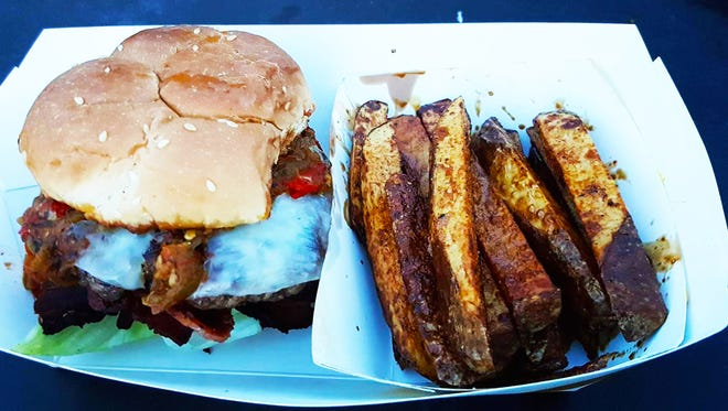Half-pound bacon cheeseburger with green chile ($8) and a side of the skin-on-fries ($3) from Woo Doggy Food Truck.