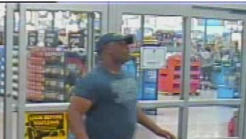 Razor suspect seen leaving Walmart on May 16, 2015.  He is wearing red shorts, a dark t-shirt, and dark ball cap.