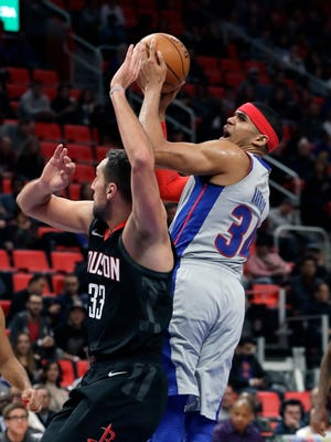 Pistons forward Tobias Harris (34) shoots over Rockets forward Ryan Anderson (33) during the first half on Saturday, Jan. 6, 2018, at Little Caesars Arena.