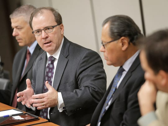 Texas Health and Human Services Commissioner Chris Traylor, second from left, discusses El Paso's medical needs during a meeting Thursday at the Greater El Paso Chamber of Commerce.