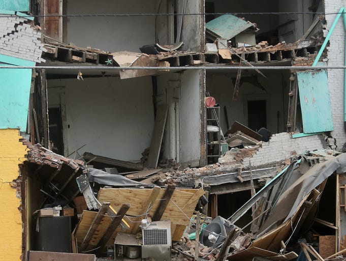 A building collapse on the corner of West Liberty Street and John Street in the West End on Monday.