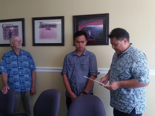The Guam Board of Registration for Professional Engineers, Architects & Land Surveyors congratulates the Engineer In Training (EIT) who has successfully completed the NCEES Fundamental Exam on April 26. Pictured, from left: H. Mark Ruth, RA, FAIA, Vice Chair; Braulio Manalo Rivera, Jr., FE(EIT); Gabriel Jugo, PE, SE, Chairman