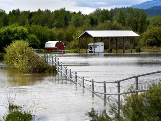 Floodwater from the Clark Fork River flows over the