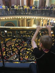 A student watches from the balcony as school choice advocates lobby legislators in April 2017 to provide more state funding for options in addition to the state's public schools.