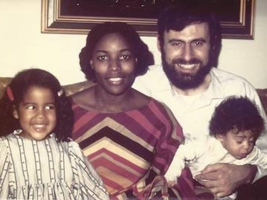 The Stockman family in 1974, when Farah (right) was an infant in her father George's arms. Also pictured, from left, are older sister Demress and mom Ida.