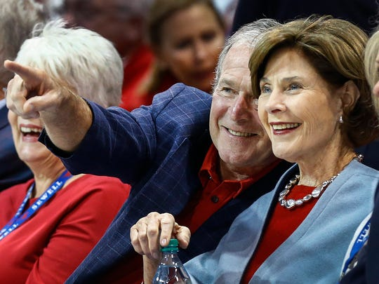 Former President George W. Bush and former first lady Laura enjoy Southern Methodist University's 103-62 victory over University of Memphis at Moody Coliseum in Dallas on Saturday, March 4, 2017.