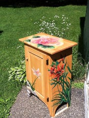 Cabinets painted by 18 artists will be sold at a live