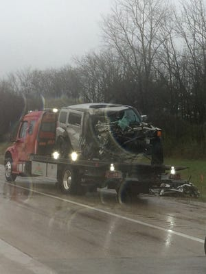 One person was arrested and another was left in critical condition after a semi and Hummer collided on I-70
