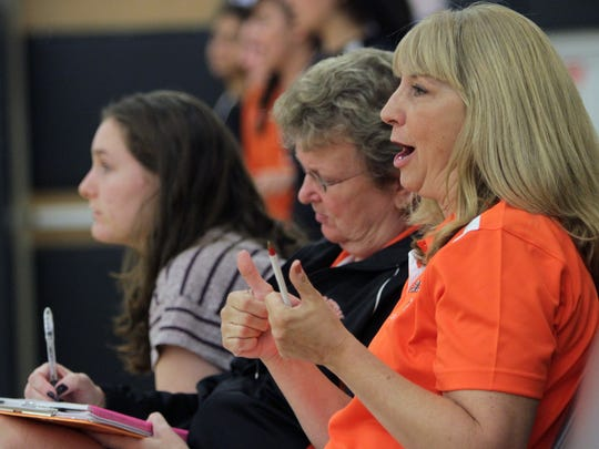 Croton-Harmon volleyball coach Robin Cooke gives the thumbs up while coaching her team while playing Pleasantville at Croton High School Sept. 25, 2012.  She is being inducted into the Westchester Sports Hall of Fame.