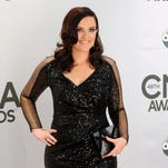 """FILE - In this Nov. 5, 2014 file photo, composer Brandy Clark arrives at the 48th annual CMA Awards in Nashville, Tenn. Clark, a Grammy Award-nominee this year for Best New Artist, and Shane McAnally, who has written songs for Lady Antebellum, Kelly Clarkson and Miranda Lambert, will create the score for """"Moonshine: That Hee Haw Musical"""" making its world premiere at Dallas Theater Center in September. (Photo by Evan Agostini/Invision/AP, File)"""