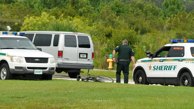 A Brevard County Sheriff's deputy near Devereux in Viera. The silver van to the left transports some of the escaped youth.