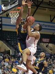 Marist guard Brian Parker (2) is fouled by West Virginia