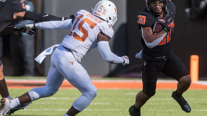 Oklahoma State running back Chuba Hubbard (30) rushed for 295 yards and a touchdown last year against Kansas State. The two teams meet again Saturday afternoon at Bill Snyder Family Stadium in Manhattan.