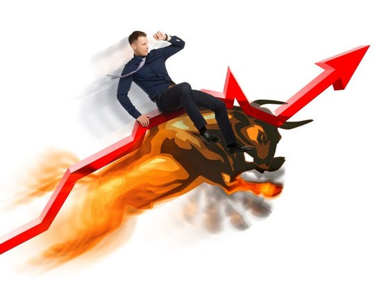 Image of an investor riding a bull market for stocks higher.