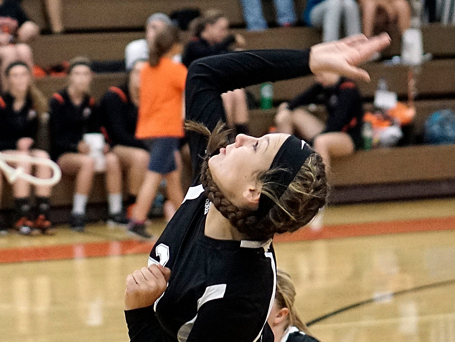 Lucas' Kexi Barnett goes for a spike during their game Tuesday at home against Mansfield Christian.