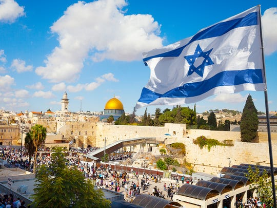 Israel flag with a view of old city Jerusalem