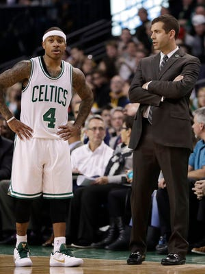 Boston Celtics guard Isaiah Thomas talks with head coach Brad Stevens as they take on the Charlotte Hornets in the second half at TD Garden.