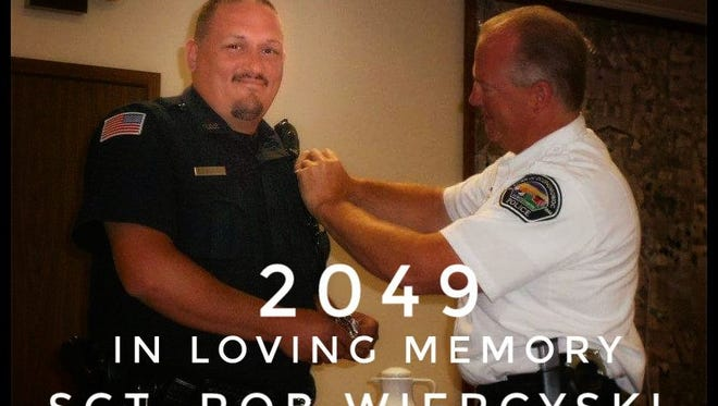 Rob Wiercyski, a town of Oconomowoc police officer, died unexpectedly at his home Tuesday, Nov. 28, 2017 A T-shirt was made to honor Wiercyski; all proceeds from their sale go to Wiercyski's family.