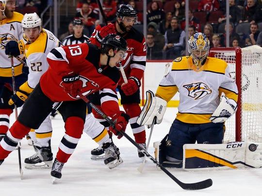 Nashville Predators goaltender Pekka Rinne (35) makes a save against New Jersey Devils center Nico Hischier (13) during the first period at Prudential Center.