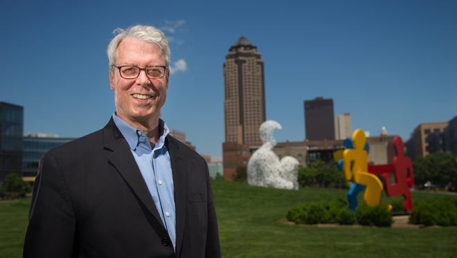 Des Moines Mayor Frank Cownie stands for a portrait in the Pappajohn Sculpture Park on June 9.