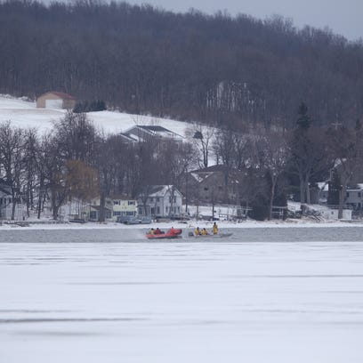 Crews search in the frigid waters of Conesus Lake on