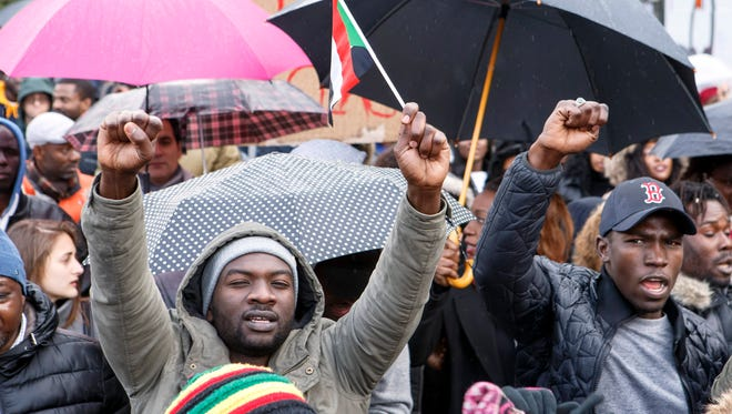 People protest against slavery and slave auctions in Libya, during a rally in Geneva, Switzerland, Nov. 25, 2017.
