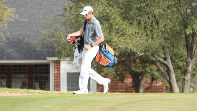 San Angelo Central High School senior Jansen Smith carries his bag between holes during the second round of the 2018 San Angelo Boys Golf Classic at Bentwood Country Club on Friday, March 9, 2018.