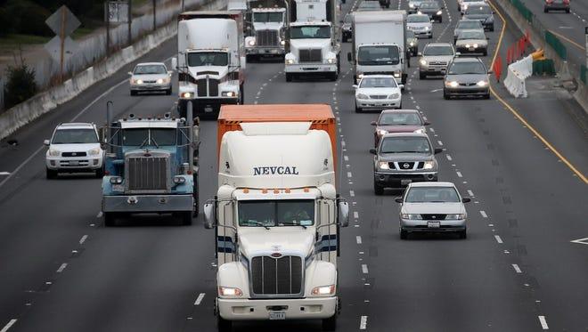 Trucks drive along Interstate 80.