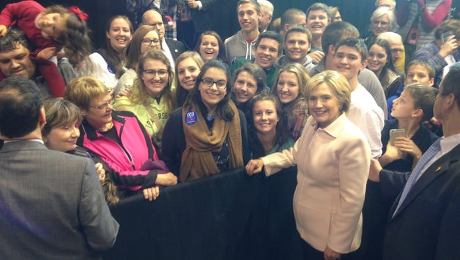 Taylor High School students pose for a photo with Hilary Clinton Friday in Iowa.