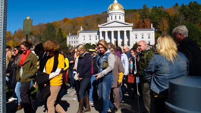 National Life Group workers joined with city employees for a walk with assistance from Montpelier Alive in support of Harwood Union families on Friday, Oct. 14, 2016.